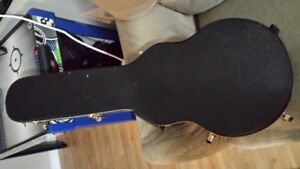 trade guitar case.  My LP one for one to fit a Jazzmaster