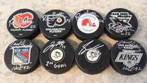 Autographed hockey pucks & Jaromir Jager game used stick