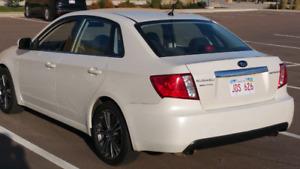 2010 Subaru Impreza AWD.