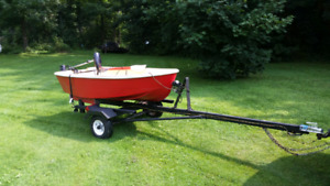 Little fishing boat and trailer