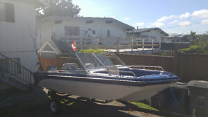 ## 15 ft BOAT TRI HULL 55 HP EVINRUDE AND TRAILER ##