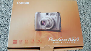 Canon PowerShot A530 Digital camera $40, Sony Digital Frame $20