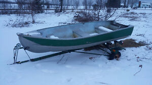 6.0 HP Evinrude , 14ft Aluminun Boat and Trailer.