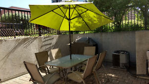Patio set (table + 6 chairs + umbrella)