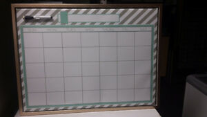 White board with monthly calendar