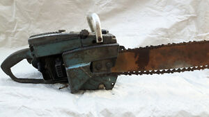 Vintage Homelite chainsaw.