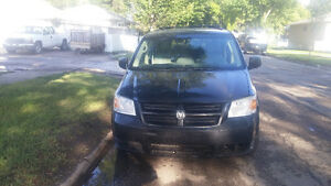 2009 Dodge Caravan with 24 months free warranty