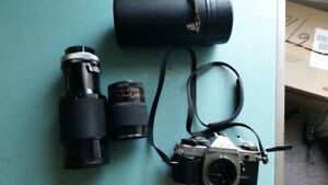 Canon ae-1 35mm slr film camera with 2 lenses