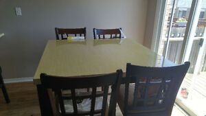 Pub Style Dinner Tables and Four Chairs