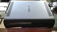 xbox 360 with 2 wireless controllers and 4 games