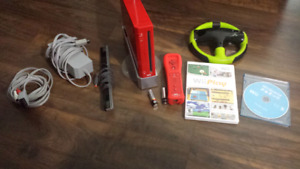 Wii console (red) with red motion plus controller and more
