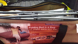 Queen sized bed in bag with stand