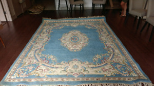 Beautiful area rug in good condition..100%  wool.