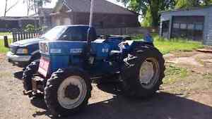 Diesel Four wheel drive tractor with attachments