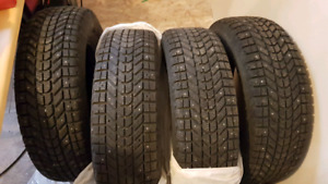 4 used studded tires.