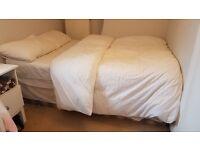 Custom built double divan bed and John Lewis mattress