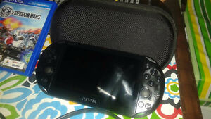 PS Vita Slim plus accessories and game