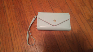 Brand new small clutch with phone pocket