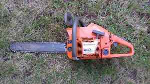 Husqvarna 257 57CC chainsaw comes with case, tools, and mask