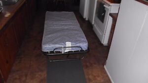 Almost new folding cot.