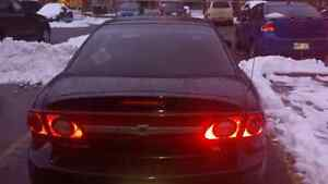 2003 black 2 door coupe  style cavilier With newer parts/battery Peterborough Peterborough Area image 1