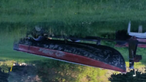 12 ft aluminum  boat Trailor and 5hp Coleman 4 stroke motor