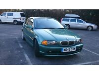 BMW 328i coupe very low miles and fsh