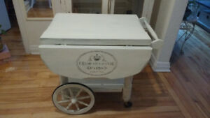 Solid wood tea cart with folding flaps in distressed white