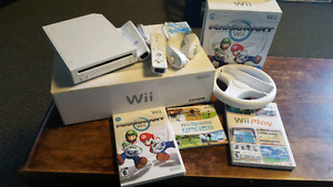 Nintendo Wii with games, remotes, nunchucks and wheel