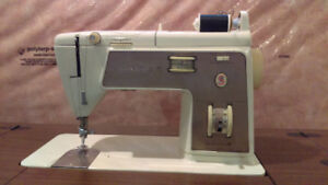 SINGER SEWING MACHINE with desk and accessories
