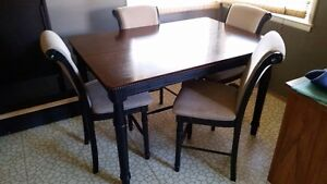 Bar height table and 8 padded chairs.