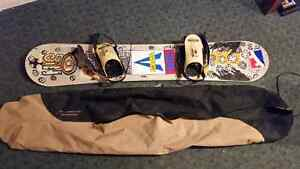 professional snowboard with burton carrying bag