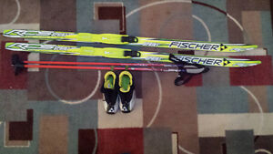 Fischer junior 140cm cross country skis, boots and poles.