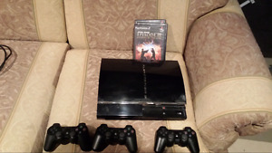 PS3 System and 3 PS2 Games