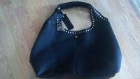Black Purse with inside zipper pouch and place for phone.