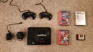 Sega Genesis, 2 controllers, 4 games, and cables