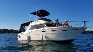 NICE SEA RAY YACHT-CRUISER CONVERTIBLE FLY BRIDGE BOAT