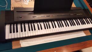 Roland keyboard  ep 7 ii digital piano 76 weighted keys