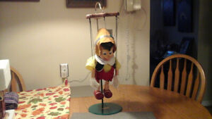 Disney singing Pinocchio puppet with strings and stand