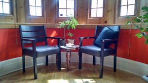 Two armchairs black stain brown leather