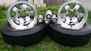 "15"" rims 5on 5"" bolt pattern with two Michelin 235 75 15"" tires"