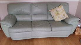 Two Green Leather Settees
