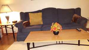 chesterfield and chair and coffee and end tables
