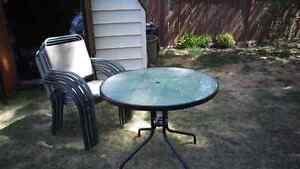 Free patio table and 6 chairs.