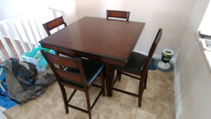 High table with 4 chairs.