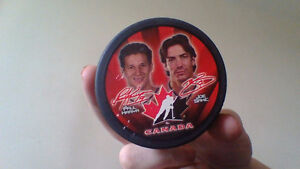 hockey plaque and puck
