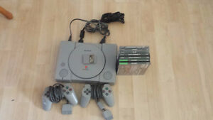 Original PS1 console + 2 controllers + games