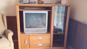 Entertainment unit with tv, remote.