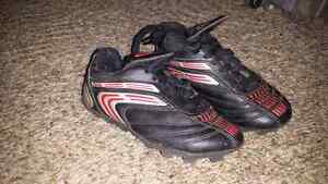 soccer shoes small and shin pads