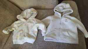 baby clothes and pjs and 2 sweaters and sokes